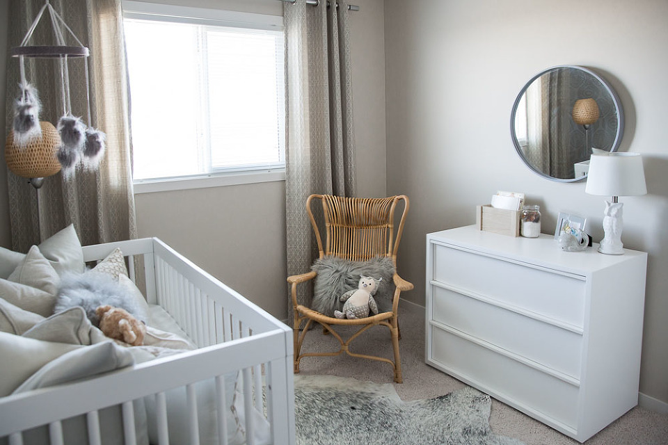 additionally the cowhide rug and feather baby mobile is introduced to further enhance the organic outdoor inspired features in the room
